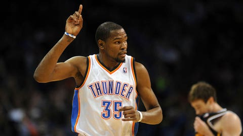 Mar 30, 2014; Oklahoma City, OK, USA;  Oklahoma City Thunder forward Kevin Durant (35) reacts after a made shot against the Utah Jazz during the third quarter at Chesapeake Energy Arena. Mandatory Credit: Mark D. Smith-USA TODAY Sports
