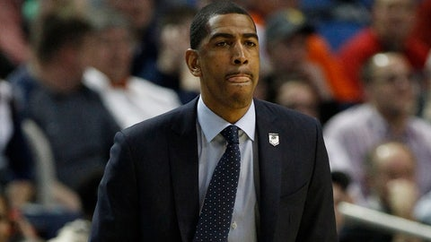 Mar 20, 2014; Buffalo, NY, USA;  Connecticut Huskies head coach Kevin Ollie works from the sidelines against Saint Joseph's Hawks in the second half of a men's college basketball game during the second round of the 2014 NCAA Tournament at First Niagara Center. Mandatory Credit: Kevin Hoffman-USA TODAY Sports