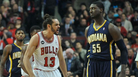 Mar 24, 2014; Chicago, IL, USA; Chicago Bulls center Joakim Noah (13) reacts after play against Indiana Pacers center Roy Hibbert (55) during the first quarter at the United Center. Mandatory Credit: David Banks-USA TODAY Sports