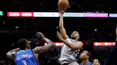 Mar 2, 2014; San Antonio, TX, USA; San Antonio Spurs guard Tony Parker (9) shoots the ball against the Dallas Mavericks during the first half at AT&T Center. Mandatory Credit: Soobum Im-USA TODAY Sports