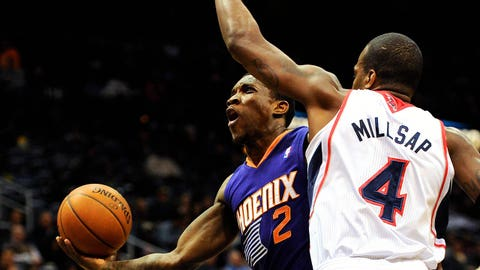 Mar 24, 2014; Atlanta, GA, USA; Phoenix Suns guard Eric Bledsoe (2) tries to reach the basket past Atlanta Hawks forward Paul Millsap (4) during the first half at Philips Arena. Mandatory Credit: Dale Zanine-USA TODAY Sports