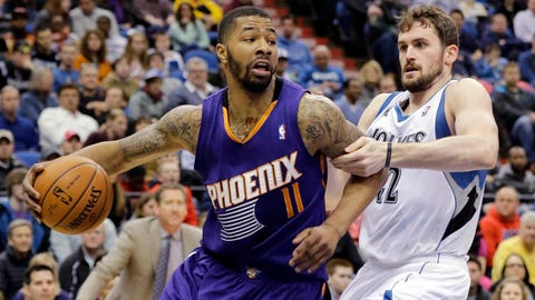 Phoenix Suns forward Markieff Morris (11) drives against Minnesota Timberwolves forward Kevin Love (42) during the second quarter of an NBA basketball game in Minneapolis, Sunday, March 23, 2014. (AP Photo/Ann Heisenfelt)