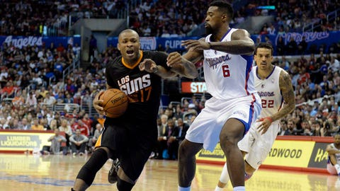 Mar 10, 2014; Los Angeles, CA, USA; Phoenix Suns small forward P.J. Tucker (17) drives against Los Angeles Clippers center DeAndre Jordan (6) during the first half at Staples Center. Mandatory Credit: Richard Mackson-USA TODAY Sports