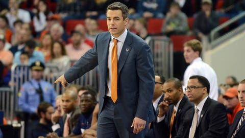 Mar 23, 2014; Raleigh, NC, USA; Virginia Cavaliers head coach Tony Bennett directs his players against the Memphis Tigers during the first half of a men's college basketball game during the third round of the 2014 NCAA Tournament at PNC Arena. Mandatory Credit: Rob Kinnan-USA TODAY Sports
