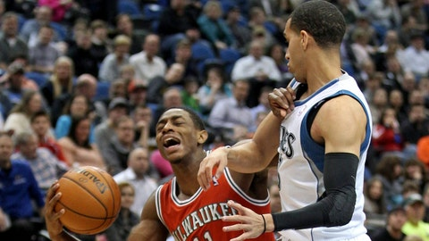 Mar 11, 2014; Minneapolis, MN, USA; Milwaukee Bucks guard Brandon Knight (11) is fouled by Minnesota Timberwolves guard Kevin Martin (23) during the first quarter at Target Center. Mandatory Credit: Brace Hemmelgarn-USA TODAY Sports