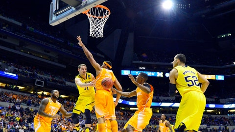 Mar 28, 2014; Indianapolis, IN, USA; Michigan Wolverines guard Nik Stauskas (11) tries to pass the ball to forward Jordan Morgan (52) against the Tennessee Volunteers in the second half in the semifinals of the midwest regional of the 2014 NCAA Mens Basketball Championship tournament at Lucas Oil Stadium. Mandatory Credit: Bob Donnan-USA TODAY Sports