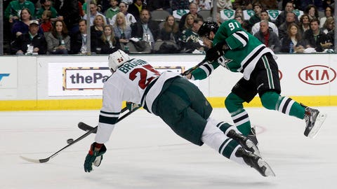 Minnesota Wild defenseman Jonas Brodin (25) defends on a shot by Dallas Stars center Tyler Seguin (91) iduirngthe first period of an NHL hockey game in Dallas on Saturday, March 8, 2014. (AP Photo/ Richard W. Rodriguez)