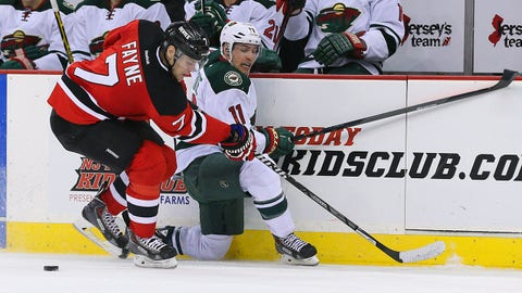 Mar 20, 2014; Newark, NJ, USA; Minnesota Wild left wing Zach Parise (11) battles for the puck with New Jersey Devils defenseman Mark Fayne (7) during the second period at the Prudential Center. Mandatory Credit: Adam Hunger-USA TODAY Sports