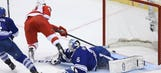 Helm's hat trick powers Red Wings past Leafs