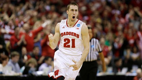 Mar 22, 2014; Milwaukee, WI, USA; Wisconsin Badgers guard Josh Gasser (21) celebrates a 3-point shot in the second half of a men's college basketball game against the Oregon Ducks during the third round of the 2014 NCAA Tournament at BMO Harris Bradley Center. Mandatory Credit: Jeff Hanisch-USA TODAY Sports