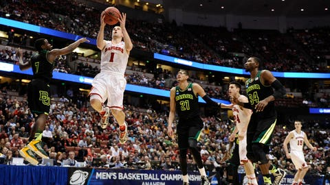 Mar 27, 2014; Anaheim, CA, USA; Wisconsin Badgers guard Ben Brust (1, right) drives to the basket against Baylor Bears guard Kenny Chery (1, left) during the second half in the semifinals of the west regional of the 2014 NCAA Mens Basketball Championship tournament at Honda Center. Mandatory Credit: Robert Hanashiro-USA TODAY Sports