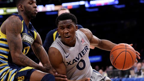 Xavier's Semaj Christon (0) protects the ball from Marquette's Jamil Wilson during the second half of an NCAA college basketball game in the quarterfinals of the Big East men's tournament Thursday, March 13, 2014, at Madison Square Garden in New York. Xavier won 68-65. (AP Photo/Frank Franklin II)