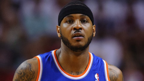 Apr 6, 2014; Miami, FL, USA; New York Knicks forward Carmelo Anthony (7) runs against the Miami Heat during the first half at American Airlines Arena. Mandatory Credit: Steve Mitchell-USA TODAY Sports