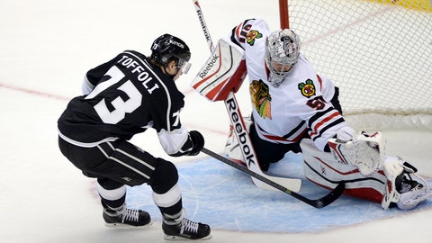 May 24, 2014; Los Angeles, CA, USA; Los Angeles Kings center Tyler Toffoli (73) scores a goal past Chicago Blackhawks goalie Corey Crawford (50) during the second period in game three of the Western Conference Final of the 2014 Stanley Cup Playoffs at Staples Center. Mandatory Credit: Richard Mackson-USA TODAY Sports