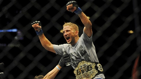May 24, 2014; Las Vegas, NV, USA; New bantamweight champion TJ Dillashaw celebrates his TKO win over opponent  Renan Barao (not pictured) following their UFC 173 bantamweight championship bout at MGM Grand Garden Arena. Mandatory Credit: Stephen R. Sylvanie-USA TODAY Sports