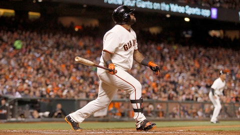 May 24, 2014; San Francisco, CA, USA; San Francisco Giants infielder Pablo Sandoval (48) hits a sacrifice fly against the Minnesota Twins in the sixth inning at AT&T Park. Mandatory Credit: Cary Edmondson-USA TODAY Sports