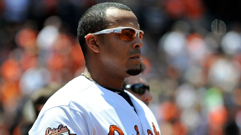 May 25, 2014; Baltimore, MD, USA; Baltimore Orioles designated hitter Nelson Cruz (23) during the national anthem before a game against the Cleveland Indians at Oriole Park at Camden Yards. The Orioles defeated the Indians 4-2. Mandatory Credit: Joy R. Absalon-USA TODAY Sports