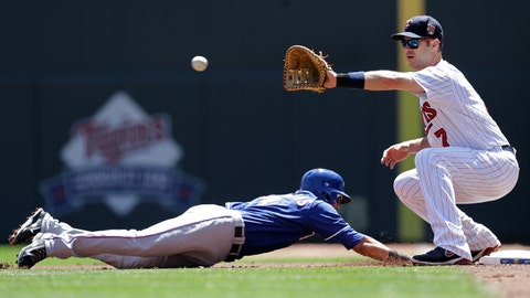Texas Rangers' Luis Sardinas, left, dives safely back to first as Minnesota Twins' Joe Mauer  reaches for the throw in the first inning of a baseball game Thursday, May 29, 2014, in Minneapolis. (AP Photo/Jim Mone)