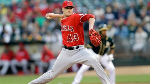 Los Angeles Angels starting pitcher Garrett Richards throws to the Oakland Athletics during the first inning of a baseball game Friday, May 30, 2014, in Oakland, Calif. (AP Photo/Marcio Jose Sanchez)