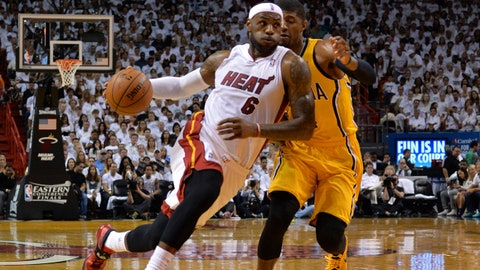 May 24, 2014; Miami, FL, USA; Miami Heat forward LeBron James (6) drives tot the basket against Indiana Pacers forward Paul George (24) in game three of the Eastern Conference Finals of the 2014 NBA Playoffs at American Airlines Arena. Mandatory Credit: Steve Mitchell-USA TODAY Sports