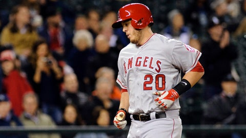 May 27, 2014; Seattle, WA, USA; Los Angeles Angels designated hitter C.J. Cron (20) scores a run after hitting a solo home run against the Seattle Mariners during the eighth inning at Safeco Field. Mandatory Credit: Steven Bisig-USA TODAY Sports
