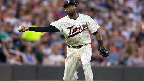 May 28, 2014; Minneapolis, MN, USA; Minnesota Twins third baseman Eduardo Nunez (9) throws the ball to first base for an out in the fourth inning against the Texas Rangers at Target Field. Mandatory Credit: Jesse Johnson-USA TODAY Sports