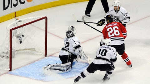 May 28, 2014; Chicago, IL, USA; Chicago Blackhawks center Michal Handzus (26) scores the game-winning goal past Los Angeles Kings goalie Jonathan Quick (32) during the second overtime in game five of the Western Conference Final of the 2014 Stanley Cup Playoffs at United Center. Mandatory Credit: David Banks-USA TODAY Sports