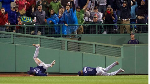 May 30, 2014; Boston, MA, USA; Tampa Bay Rays right fielder Wil Myers (9) and center fielder Desmond Jennings (8) collide going after a hit by Boston Red Sox catcher A.J. Pierzynski (not pictured) during the tenth inning at Fenway Park. The Boston Red Sox defeated Tampa Bay Rays 3-2. Mandatory Credit: David Butler II-USA TODAY Sports