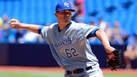 May 31, 2014; Toronto, Ontario, CAN; Kansas City Royals starting pitcher Aaron Brooks delivers a pitch against Toronto Blue Jays at Rogers Centre. Mandatory Credit: Dan Hamilton-USA TODAY Sports