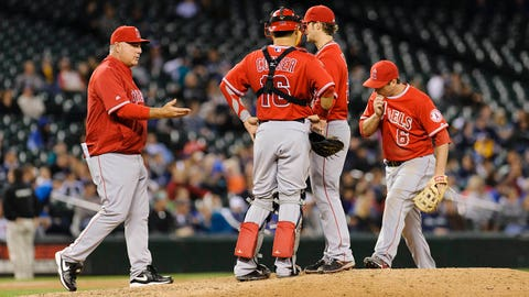 May 28, 2014; Seattle, WA, USA; Los Angeles Angels manager Mike Scioscia (14) pulls Los Angeles Angels starting pitcher C.J. Wilson (33) from the game during the ninth inning against the Seattle Mariners at Safeco Field. Seattle defeated Los Angeles 3-1. Mandatory Credit: Steven Bisig-USA TODAY Sports