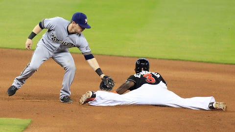 Miami Marlins' Adeiny Hechavarria, right, beats the tag by Milwaukee Brewers second baseman Scooter Gennett to steal second in the seventh inning of their baseball game in Miami, Saturday, May 24, 2014. (AP Photo/Joe Skipper)