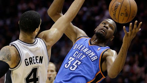 Oklahoma City Thunder's Kevin Durant (35) is pressured by San Antonio Spurs' Danny Green (4) during the second half of Game 5 of the Western Conference finals NBA basketball playoff series, Thursday, May 29, 2014, in San Antonio. San Antonio won 117-89. (AP Photo/Eric Gay)