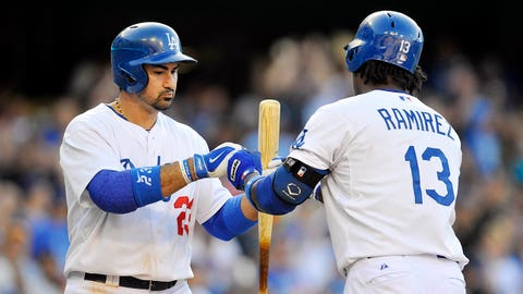 May 31, 2014; Los Angeles, CA, USA; Los Angeles Dodgers shortstop Hanley Ramirez (13) is congratulated by first baseman Adrian Gonzalez (23) after hitting a solo home run in the sixth inning against the Pittsburgh Pirates at Dodger Stadium. Mandatory Credit: Gary A. Vasquez-USA TODAY Sports
