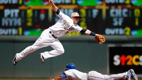 May 26, 2014; Minneapolis, MN, USA; Texas Rangers shortstop Elvis Andrus (1) steals second base as Minnesota Twins second baseman Brian Dozier (2) tries to handle the wide throw in the 8th inning at Target Field. The Rangers win 7-2. Mandatory Credit: Bruce Kluckhohn-USA TODAY Sports