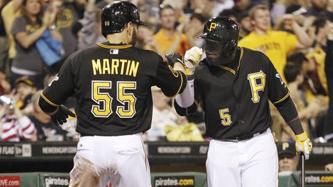 May 24, 2014; Pittsburgh, PA, USA; Pittsburgh Pirates catcher Russell Martin (55) is greeted by right fielder Josh Harrison (5) after Martin scored a run against the Washington Nationals during the seventh inning at PNC Park. The Pirates won 3-2. Mandatory Credit: Charles LeClaire-USA TODAY Sports