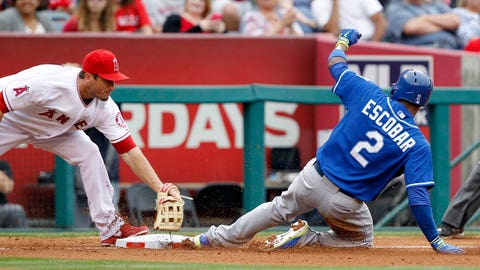 Kansas City Royals' Alcides Escobar, right, steals third base, as Los Angeles Angels third baseman David Freese can't make the tag in time, in the fourth inning of a baseball game Saturday, May 24, 2014, in Anaheim, Calif. (AP Photo/Alex Gallardo)
