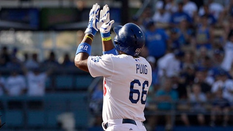 Jun 1, 2014; Los Angeles, CA, USA; Los Angeles Dodgers right fielder Yasiel Puig (66) reacts after a stand up double during the first inning against the Pittsburgh Pirates at Dodger Stadium. Mandatory Credit: Richard Mackson-USA TODAY Sports