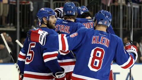 Jun 11, 2014; New York, NY, USA; New York Rangers players celebrate after game four of the 2014 Stanley Cup Final against the Los Angeles Kings at Madison Square Garden. Mandatory Credit: Jerry Lai-USA TODAY Sports
