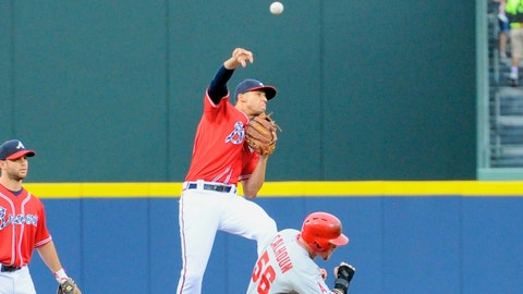 Jun 13, 2014; Atlanta, GA, USA; Atlanta Braves shortstop Andrelton Simmons (19) tries to turn a double play over Los Angeles Angels right fielder Kole Calhoun (56) during the first inning at Turner Field. Mandatory Credit: Dale Zanine-USA TODAY Sports