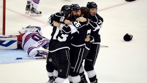Jun 13, 2014; Los Angeles, CA, USA; New York Rangers goalie Henrik Lundqvist (30) reacts as the Los Angeles Kings celebrate the game-winning goal by defenseman Alec Martinez during the second overtime period in game five of the 2014 Stanley Cup Final at Staples Center. Mandatory Credit: Richard Mackson-USA TODAY Sports