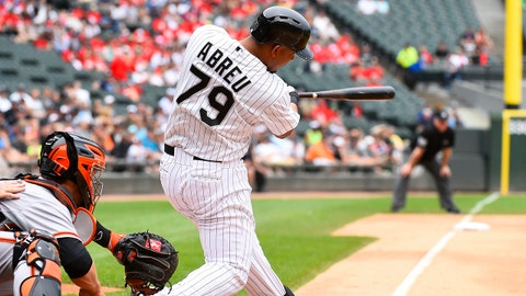Jun 18, 2014; Chicago, IL, USA; Chicago White Sox first baseman Jose Abreu (79) hits a two run home run against San Francisco Giants starting pitcher Tim Hudson (not pictured) during the first inning at U.S Cellular Field. Mandatory Credit: Mike DiNovo-USA TODAY Sports