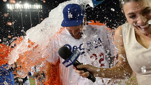 Jun 18, 2014; Los Angeles, CA, USA;    Los Angeles Dodgers starting pitcher Clayton Kershaw (22) is dunked with Powerade as he gives an interview following his no hitter against the Colorado Rockies at Dodger Stadium. Dodgers won 8-0.Mandatory Credit: Jayne Kamin-Oncea-USA TODAY Sports
