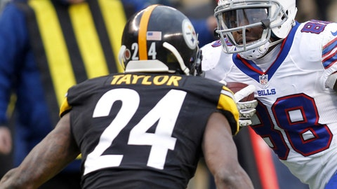 Nov 10, 2013; Pittsburgh, PA, USA; Buffalo Bills wide receiver Marquise Goodwin (88) runs after a pass reception as Pittsburgh Steelers cornerback Ike Taylor (24) defends during the fourth quarter at Heinz Field. The Pittsburgh Steelers won 23-10.  Mandatory Credit: Charles LeClaire-USA TODAY Sports