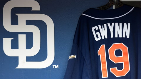 Jun 18, 2014; San Diego, CA, USA; A jersey of San Diego Padres former player Tony Gwynn (19) hangs in the dugout during a game against the Seattle Mariners at Petco Park. Gwynn passed away on June 16th. Mandatory Credit: Jake Roth-USA TODAY Sports