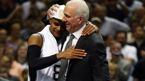 SAN ANTONIO, TX - JUNE 15: Gregg Popovich celebrates with Patty Mills #8 of the San Antonio Spurs after defeating the Miami Heat in Game Five of the 2014 NBA Finals at the AT&T Center on June 15, 2014 in San Antonio, Texas. NOTE TO USER: User expressly acknowledges and agrees that, by downloading and or using this photograph, User is consenting to the terms and conditions of the Getty Images License Agreement.  (Photo by Andy Lyons/Getty Images)