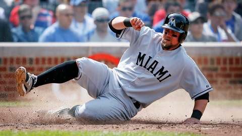 Miami Marlins' Casey McGehee slides into home on a hit by Jacob Realmuto against the Chicago Cubs during the seventh inning of a baseball game on Sunday, June 8, 2014, in Chicago. (AP Photo/Andrew A. Nelles)