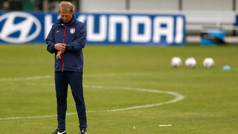 United States' head coach Juergen Klinsmann checks his watch before the start of a training session at the Sao Paulo FC training center in Sao Paulo, Brazil, Wednesday, June 11, 2014. The U.S. will play in group G of the 2014 soccer World Cup. (AP Photo/Julio Cortez)