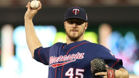 Minnesota Twins pitcher Phil Hughes throws against the Houston Astros in the first inning of a baseball game, Friday, June 6, 2014, in Minneapolis. (AP Photo/Jim Mone)