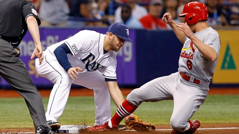 St. Louis Cardinals' Peter Bourjos slides in safely to third base ahead of a tag from Tampa Bay Rays' Evan Longoria during the fourth inning of a baseball game Wednesday, June 11, 2014, in St. Petersburg, Fla. (AP Photo/Mike Carlson)