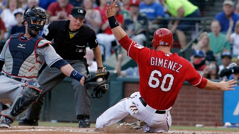 Cleveland Indians catcher Yan Gomes, left, misses the tag as Texas Rangers' Chris Gimenez (60) slides into home during the second inning of a baseball game, Friday, June 6, 2014, in Arlington, Texas. (AP Photo/Brandon Wade)